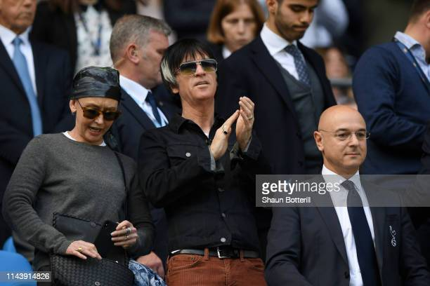 Johnny Marr guitarist of The Smiths looks on alongside Daniel Levy Chairman of Tottenham Hotspur prior to the Premier League match between Manchester...