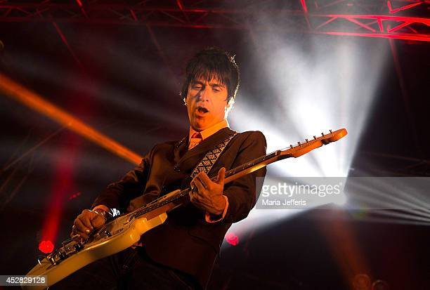 Johnny Marr performs on stage at Deer Shed Festival at Baldersbey Park Topcliffe on July 26 2014 in Thirsk United Kingdom