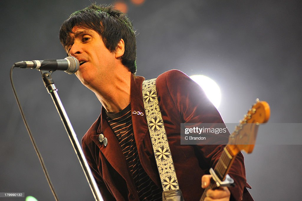 Johnny Marr performs on stage during Day 3 of Bestival 2013 at Robin Hill Country Park on September 7, 2013 in Newport, Isle of Wight.