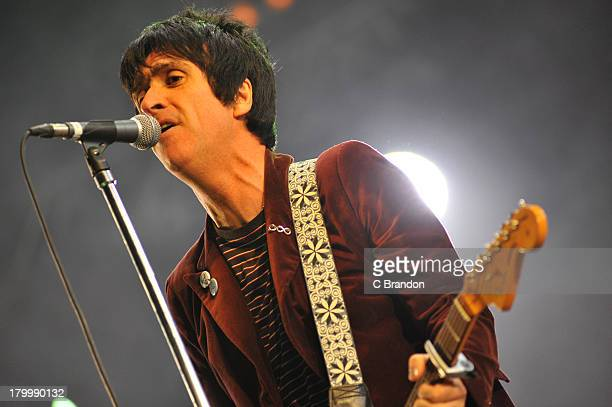 Johnny Marr performs on stage during Day 3 of Bestival 2013 at Robin Hill Country Park on September 7 2013 in Newport Isle of Wight