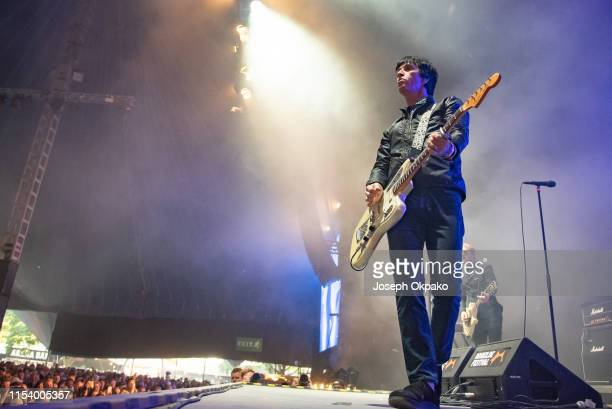 Johnny Marr performs on stage on Day 7 of Roskilde Festival on July 5 2019 in Roskilde Denmark