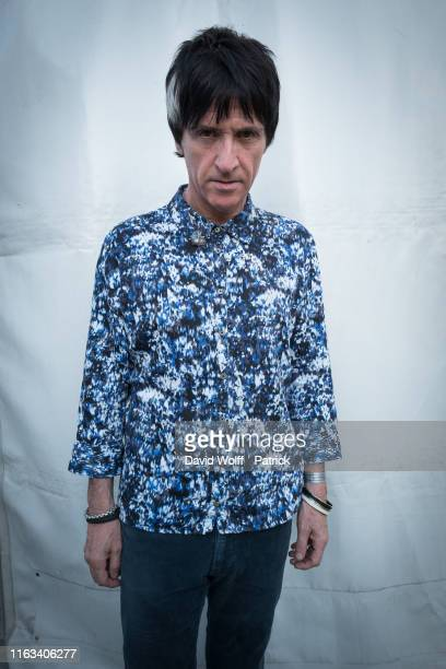 Johnny Marr poses for a portrait at Rock en Seine on August 23, 2019 in Saint-Cloud, France.