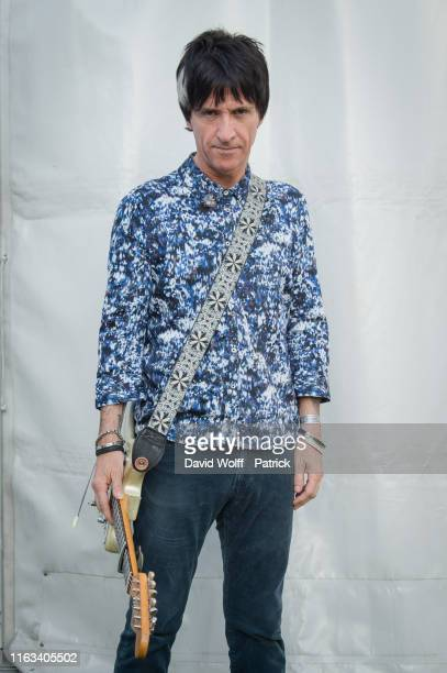 Johnny Marr poses for exclusive portrait session at Rock en Seine on August 23, 2019 in Saint-Cloud, France.