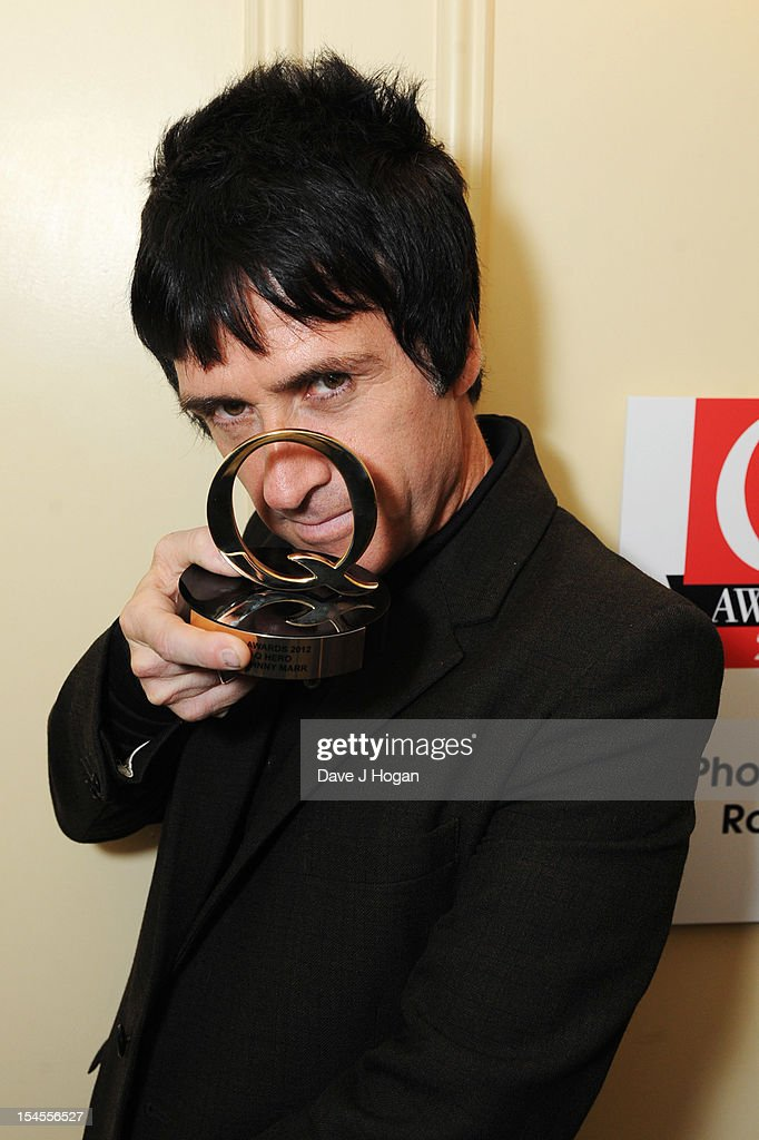 Johnny Marr poses in the press room at the Q Awards 2012 at The Grosvenor House Hotel on October 22, 2012 in London, England.