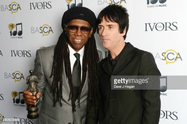 Johnny Marr poses with Nile Rogers after presenting him with the Special International Award in the winners room at The Ivor Novello Awards at The...