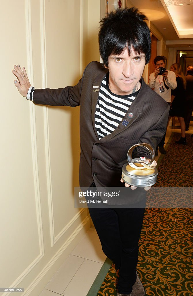 Johnny Marr, winner of the Gibson Les Paul award, poses in the press room at the Xperia Access Q Awards at The Grosvenor House Hotel on October 22, 2014 in London, England.