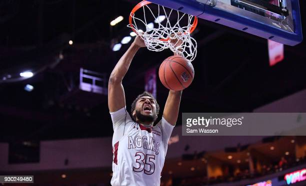 Johnny McCants of the New Mexico State Aggies dunks against the Grand Canyon Lopes during the championship game of the Western Athletic Conference...