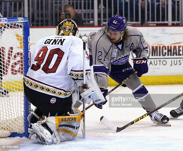 Johnny McInnis of Orlando Solar Bears is stopped by Matt Ginn of the Atlanta Gladiators at the Amway Center on February 13 2016 in Orlando Florida