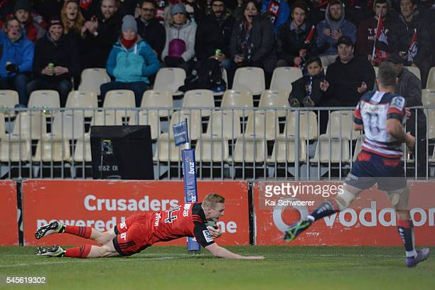 Johnny McNicholl of the Crusaders dives over to score a try during the round 16 Super Rugby match between the Crusaders and the Rebels at AMI Stadium...