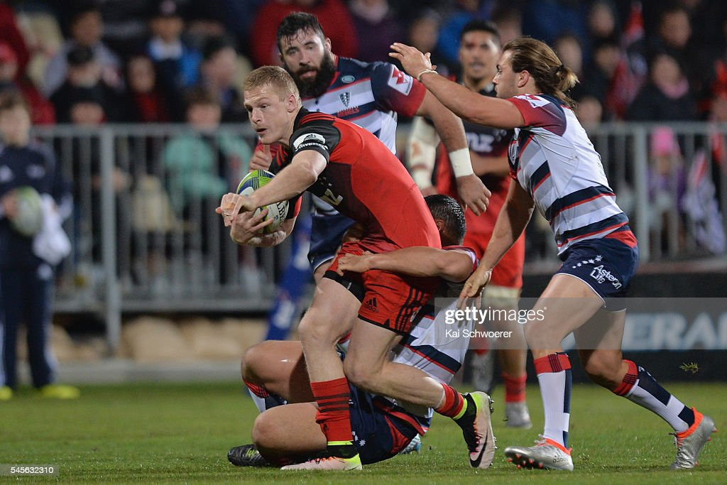 Johnny McNicholl of the Crusaders runs through to score a try during the round 16 Super Rugby match between the Crusaders and the Rebels at AMI Stadium on July 9, 2016 in Christchurch, New Zealand.