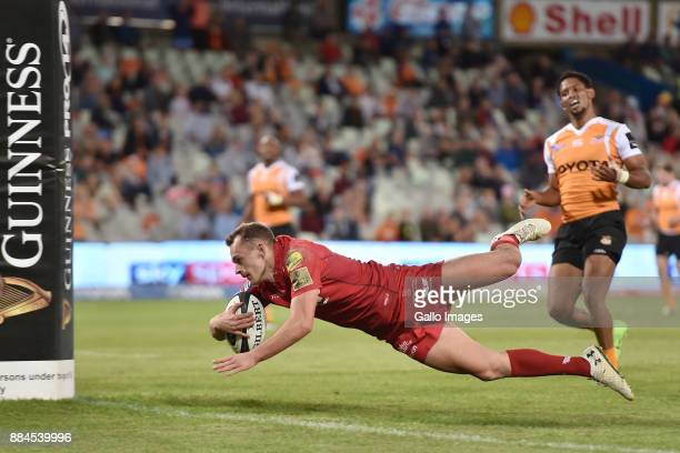 Johnny McNicholl of the Scarlets scoring his try during the Guinness Pro14 match between Toyota Cheetahs and Scarlets at Toyota Stadium on December...