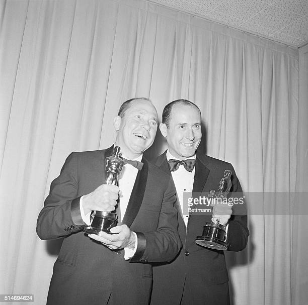 Johnny Mercer and Henry Mancini stand happily with their Oscar awards for 'Days of Wine and Roses' in the 1963 'Best Song' category