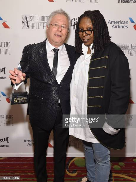 Johnny Mercer Award Honoree Alan Menken poses with award and Whoopi Goldberg backstage at the Songwriters Hall Of Fame 48th Annual Induction and...