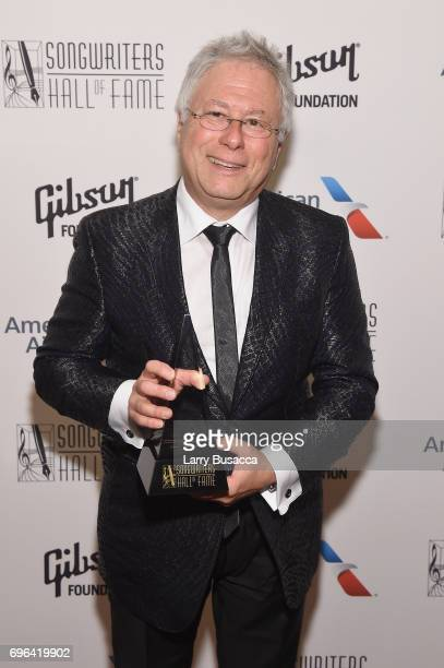 Johnny Mercer Award Honoree Alan Menken poses with award backstage at the Songwriters Hall Of Fame 48th Annual Induction and Awards at New York...