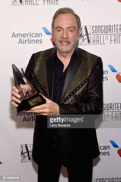 Johnny Mercer Award Honoree Neil Diamond poses with his award backstage during the Songwriters Hall of Fame 49th Annual Induction and Awards Dinner...