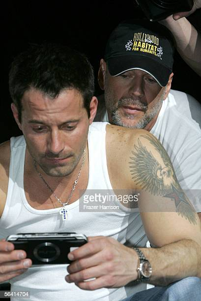 Johnny Messner and Bruce Willis are seen onstage during Playstation BANDtogether a benefit presented by Sony Computer Enterainment America and the...
