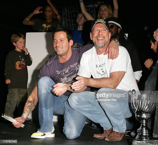 Johnny Messner and Bruce Willis during Sony Computer Entertainment America and the Bruce Willis Foundation Present Playstation BANDtogether Inside at...