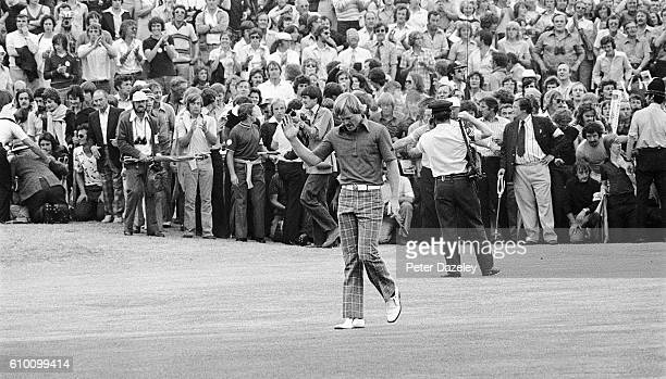 Johnny Miller of the United States the champion breaks through the crowds on thefinal hole during the final round of the 105th Open Championship...