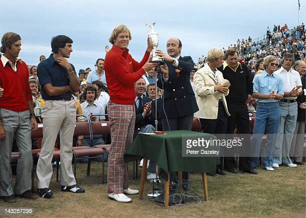 Johnny Miller of the USA receives the trophy from the captain of Royal Birkdale Golf Club also in the picture Mark James of England Severiano...