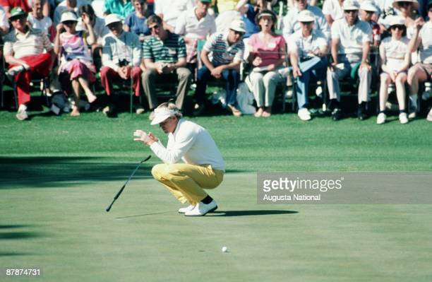 Johnny Miller reacts to missing his putt during the 1986 Masters Tournament at Augusta National Golf Club in April 1986 in Augusta Georgia