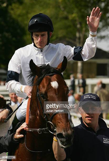 Johnny Murtagh and Motivator return after scoring an easy victory in The Totesport Dante Stakes Race run at York Racecourse on May 12 2005 in York...