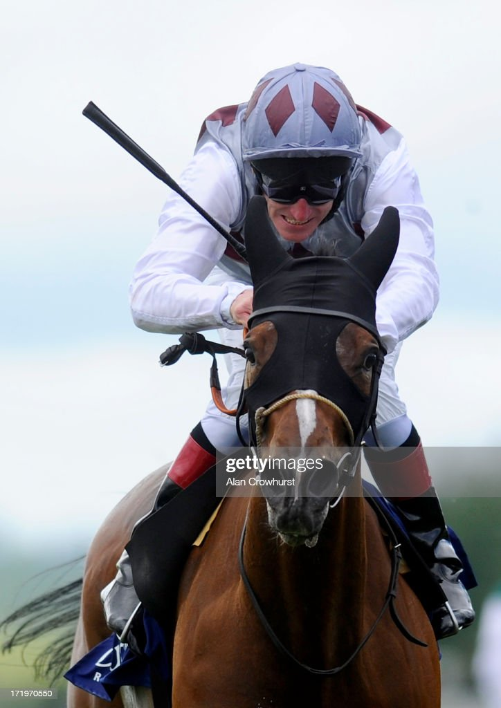 Johnny Murtagh riding Ambivalent win the Oxigen Enviromental Pretty Polly Stakes at Curragh racecourse on June 30, 2013 in Kildare, Ireland.