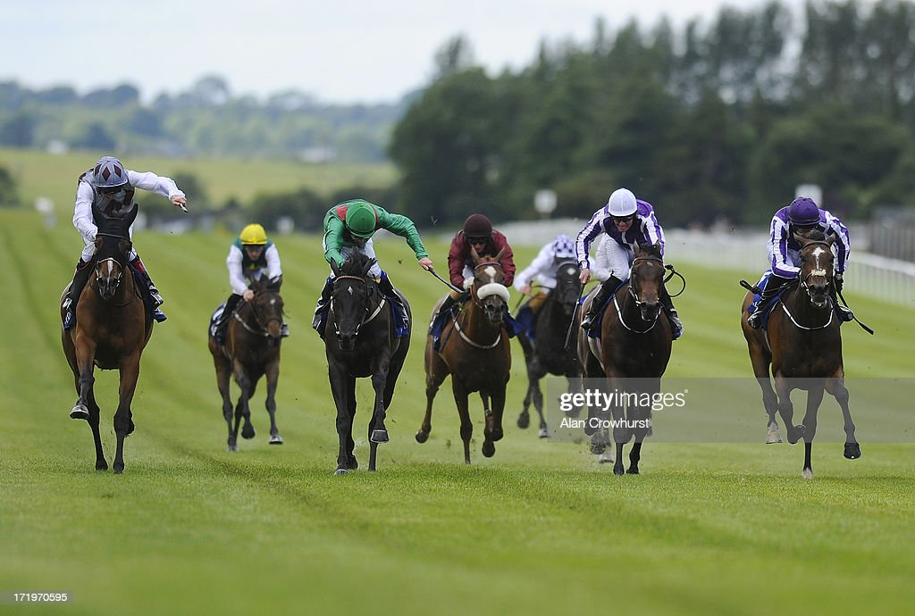 Johnny Murtagh riding Ambivalent (L) win the Oxigen Enviromental Pretty Polly Stakes at Curragh racecourse on June 30, 2013 in Kildare, Ireland.