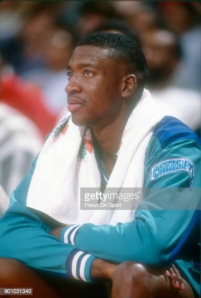 Johnny Newman 22 of the Charlotte Hornets looks on from the bench against the Washington Bullets during an NBA basketball game circa 1991 at the...