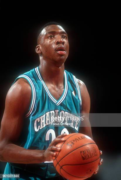Johnny Newman 22 of the Charlotte Hornets shoots a free throw against the Washington Bullets during an NBA basketball game circa 1991 at the Capital...