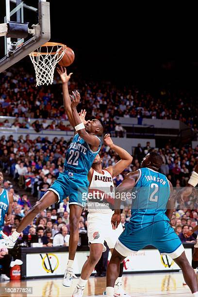 Johnny Newman of the Charlotte Hornets shoots against Kevin Duckworth of the Portland Trail Blazers during a game played in 1992 at the Veterans...