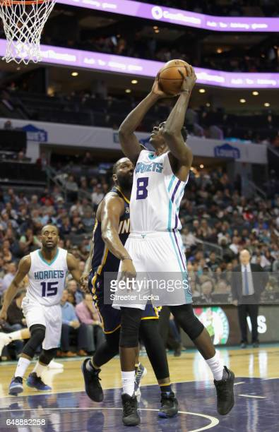 Johnny O'Bryant III of the Charlotte Hornets drives to the basket against Al Jefferson of the Indiana Pacers during their game at Spectrum Center on...