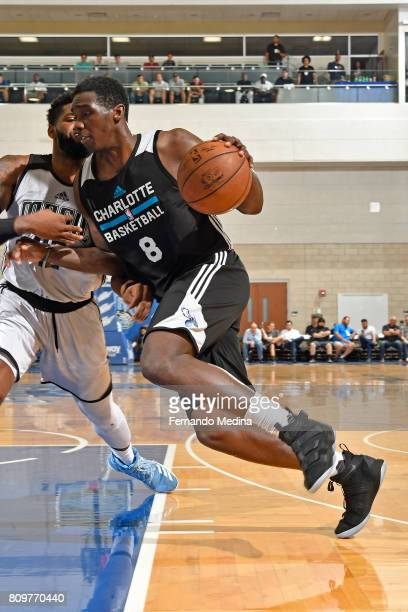Johnny O'Bryant III of the Charlotte Hornets drives to the basket against the Orlando Magic during the Mountain Dew Orlando Pro Summer League on July...