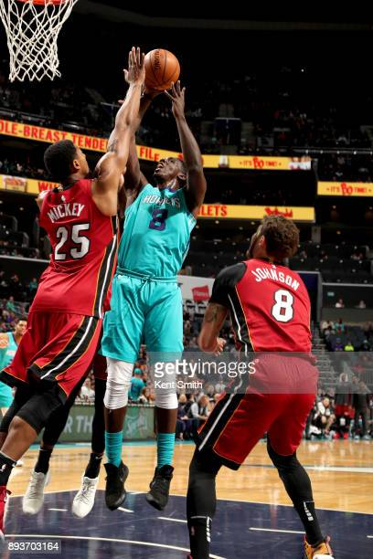 Johnny O'Bryant III of the Charlotte Hornets goes to the basket against the Miami Heat on December 15 2017 at Spectrum Center in Charlotte North...