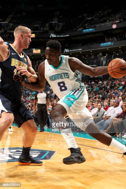 Johnny O'Bryant III of the Charlotte Hornets handles the ball against the Denver Nuggets on October 25 2017 at Spectrum Center in Charlotte North...