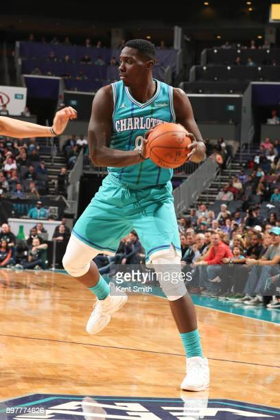 Johnny O'Bryant III of the Charlotte Hornets handles the ball against the Milwaukee Bucks on December 23 2017 at the Spectrum Center in Charlotte...