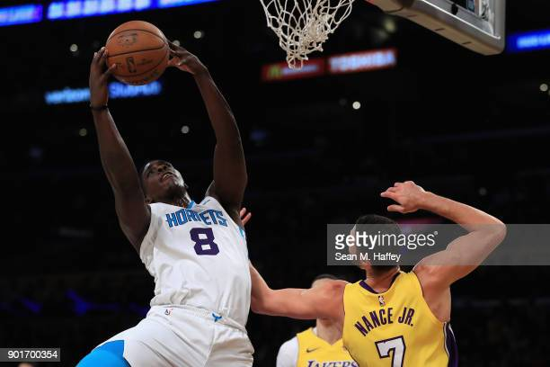 Johnny O'Bryant III of the Charlotte Hornets reboounds over Larry Nance Jr #7 of the Los Angeles Lakers during the first half of a game at Staples...