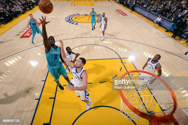 Johnny O'Bryant III of the Charlotte Hornets shoots the ball against the Golden State Warriors on December 29 2017 at ORACLE Arena in Oakland...