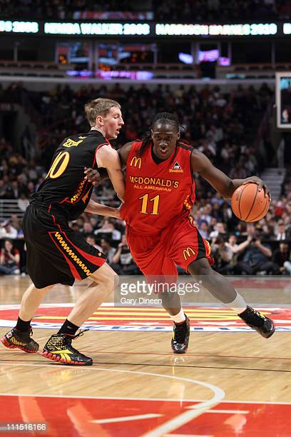 Johnny O'Bryant III of the East Team drives to the basket against Cody Zeller of the West Team during the 2011 McDonald's All American High School...