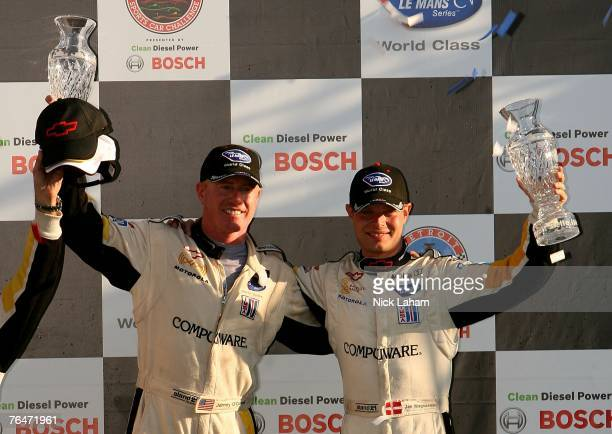 Johnny O'Connell and Jan Magnussen drivers of the Corvette Racing Chevrolet C6R celebrate winning the GT1 class in the American Le Mans Series...