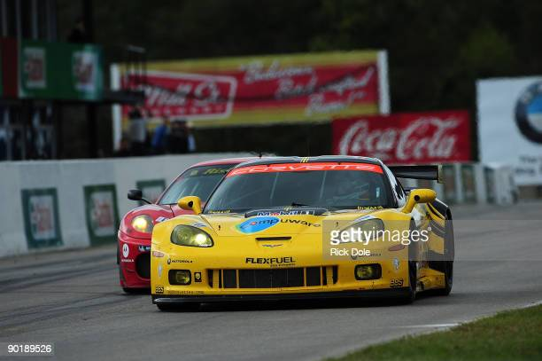 Johnny O'Connell in the Corvette Racing C6R leads Jamie Meloin the Risi Competizione Ferrari 430 during the American Le Mans Series Mobil 1 Presents...