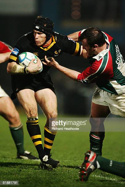 Johnny O'Connor of Wasps is tackled by Leicester's George Chuter during the Heineken Cup match between London Wasps and Leicester Tigers at the...