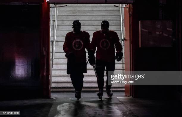 Johnny Oduya and Zack Smith of the Ottawa Senators walk down to the ice for practice at Ericsson Globe on November 7 2017 in Stockholm Sweden