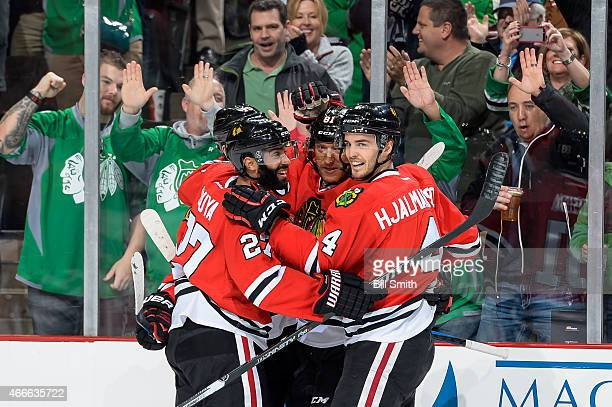 Johnny Oduya Marian Hossa and Niklas Hjalmarsson of the Chicago Blackhawks celebrate after Jonathan Toews scored his second goal in the first period...