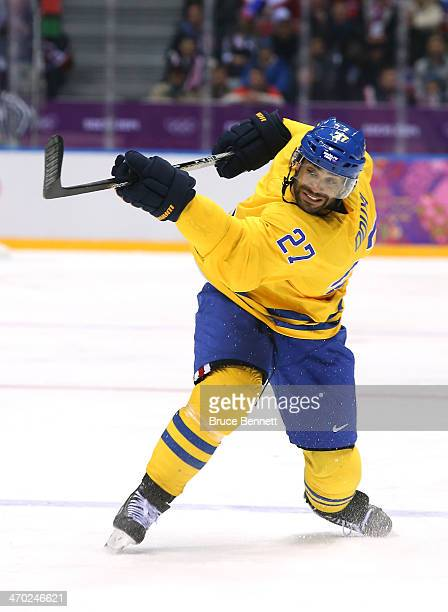 Johnny Oduya of Sweden fires the puck in the third period against Slovenia during the Men's Ice Hockey Quarterfinal Playoff on Day 12 of the 2014...
