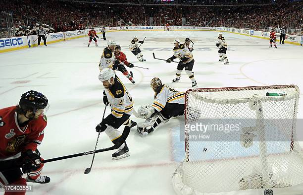 Johnny Oduya of the Chicago Blackhawks scores a goal in the third period against goalie Tuukka Rask of the Boston Bruins in Game One of the NHL 2013...