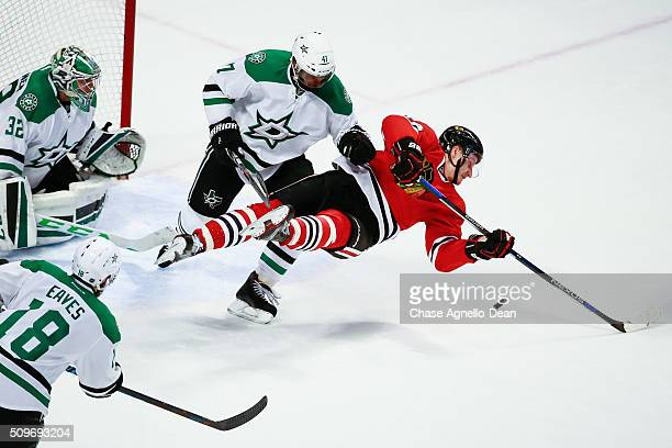 Johnny Oduya of the Dallas Stars hits Jiri Sekac of the Chicago Blackhawks in the third period of the NHL game at the United Center on February 11...