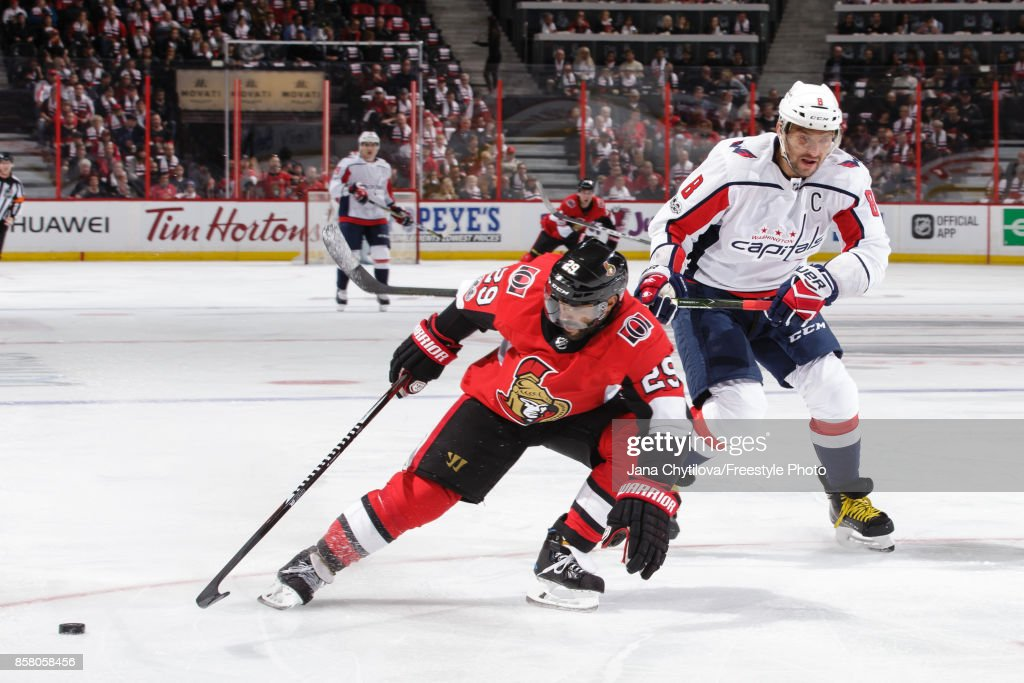 Johnny Oduya #29 of the Ottawa Senators knocks the puck away from a streaking Alex Ovechkin #8 of the Washington Capitals in the first period at Canadian Tire Centre on October 5, 2017 in Ottawa, Ontario, Canada.