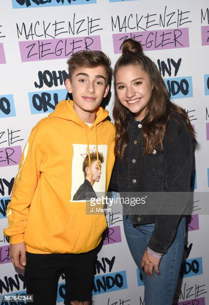 Johnny Orlando Mackenzie Ziegler pose during a meet and greet on their Day NIght tour at Mr Smalls on October 28 2017 in Millvale Pennsylvania