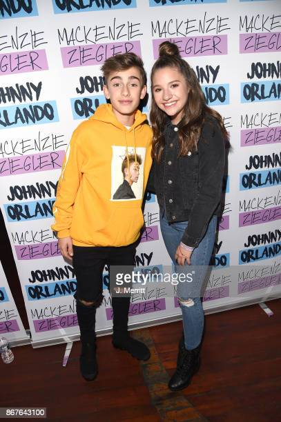 Johnny Orlando Mackenzie Ziegler pose during a meet and greet on their 'Day NIght' tour at Mr Smalls on October 28 2017 in Millvale Pennsylvania