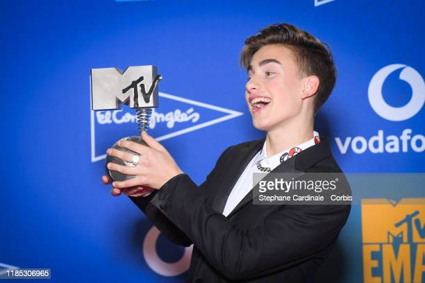 Johnny Orlando poses with Best Canadian Act Award in the winner room during the MTV EMAs 2019 at FIBES Conference and Exhibition Centre on November...